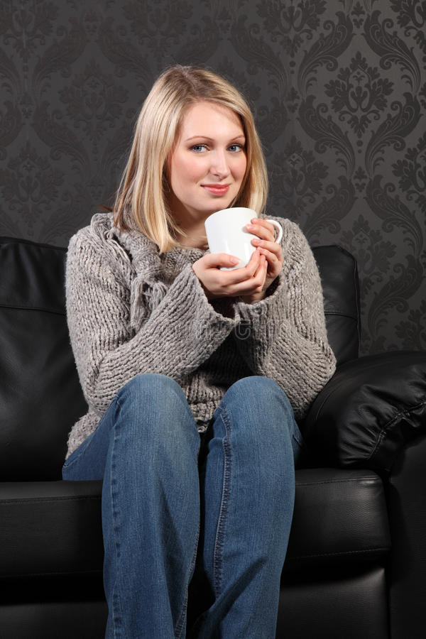 Free Happy Young Woman Relaxed At Home Drinking Coffee Royalty Free Stock Images - 19545489