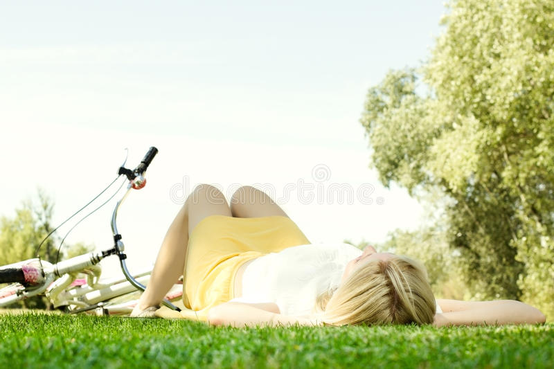 Happy young woman relaxing stock photos