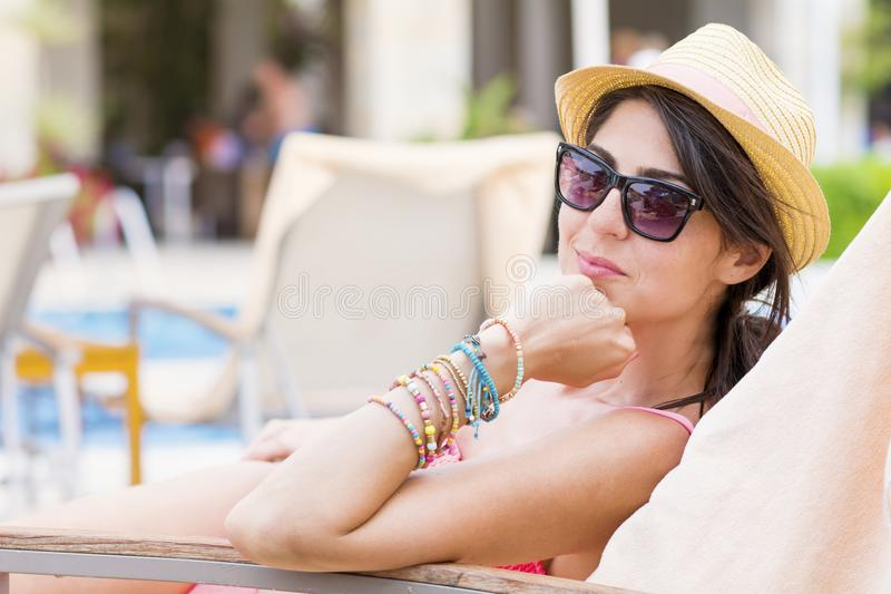 Young Woman Relaxing on the Beach. Happy young woman relaxing on the beach. Summer vacation royalty free stock photo