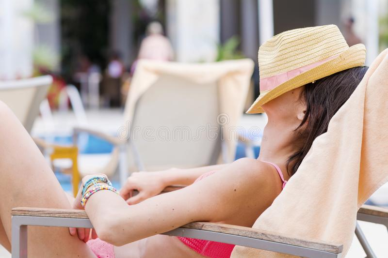 Young Woman Relaxing on the Beach. Happy young woman relaxing on the beach. Summer vacation royalty free stock images