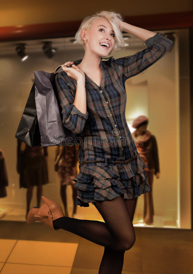 Happy young woman shopping royalty free stock photo