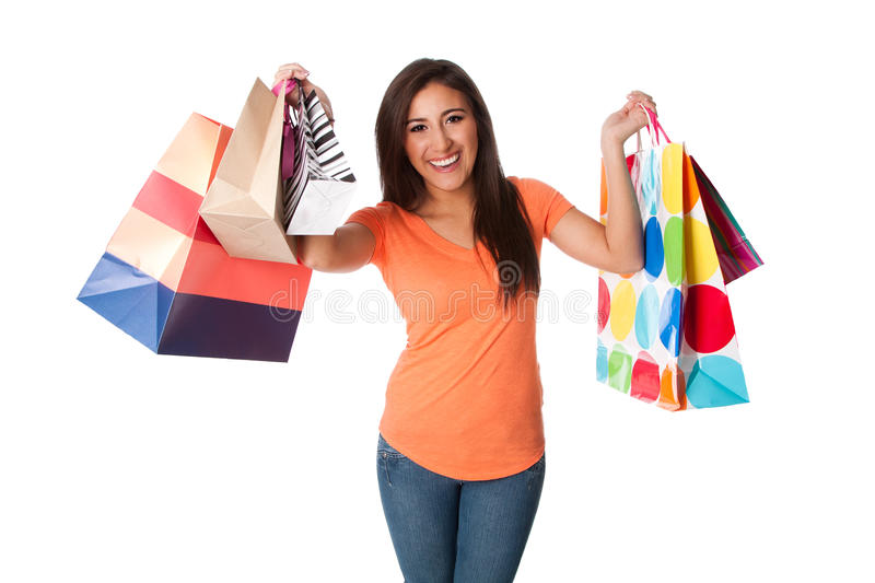 Happy young woman on shopping spree royalty free stock photo