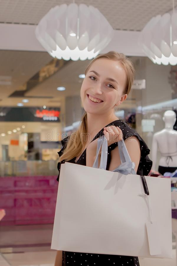 Happy young woman show shopping bag, sale, consumerism and people concept. fashion tone royalty free stock photo