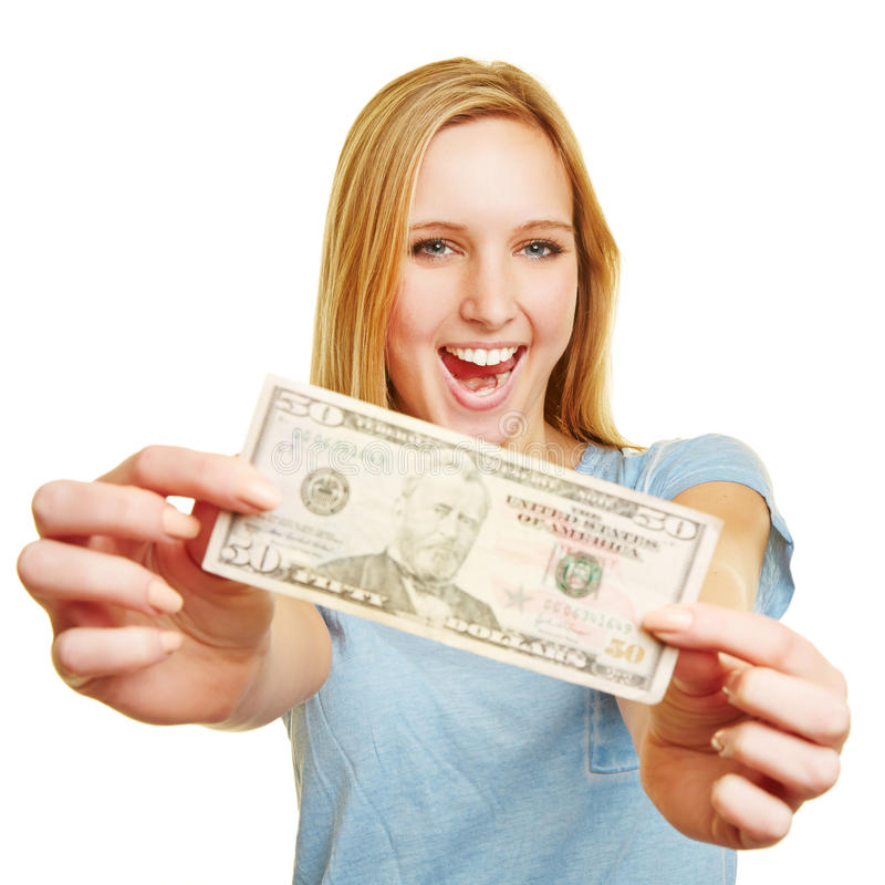 Happy young woman showing 50 dollar bill. In her hands stock image