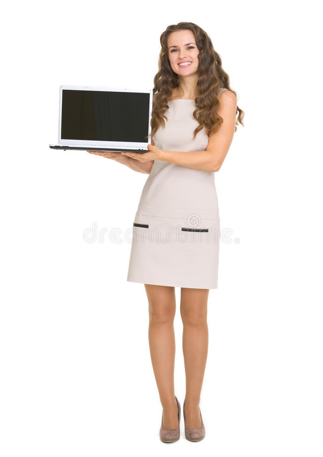 Happy young woman showing laptop