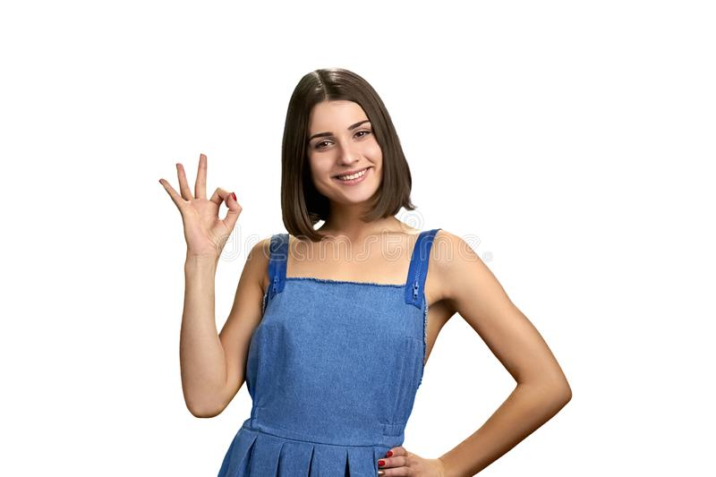 Happy young woman showing ok sign with fingers. stock photography