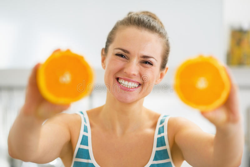Download Happy Young Woman Showing Slices Of Orange Stock Photo - Image: 31897358