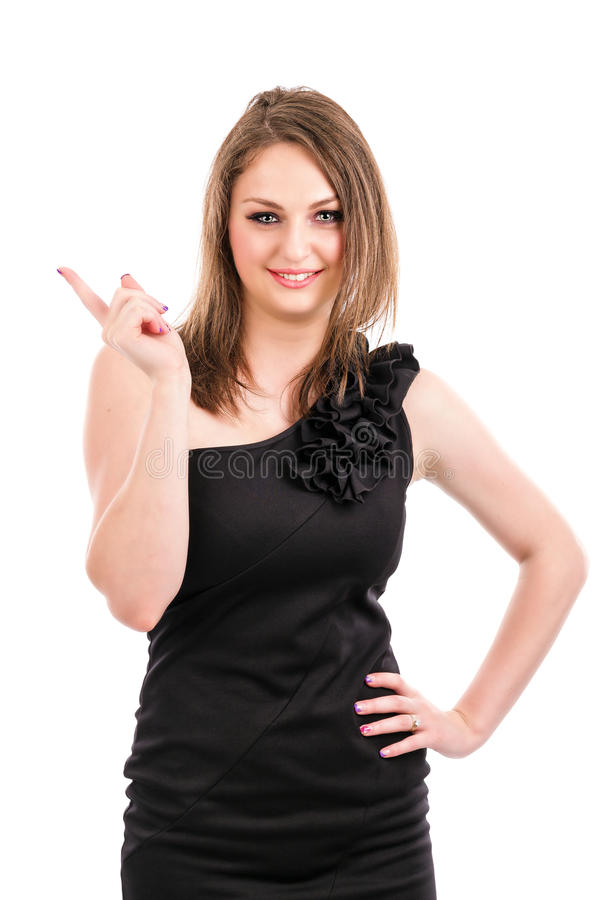 Happy Young Woman Showing Something With Her Finger Stock Photo