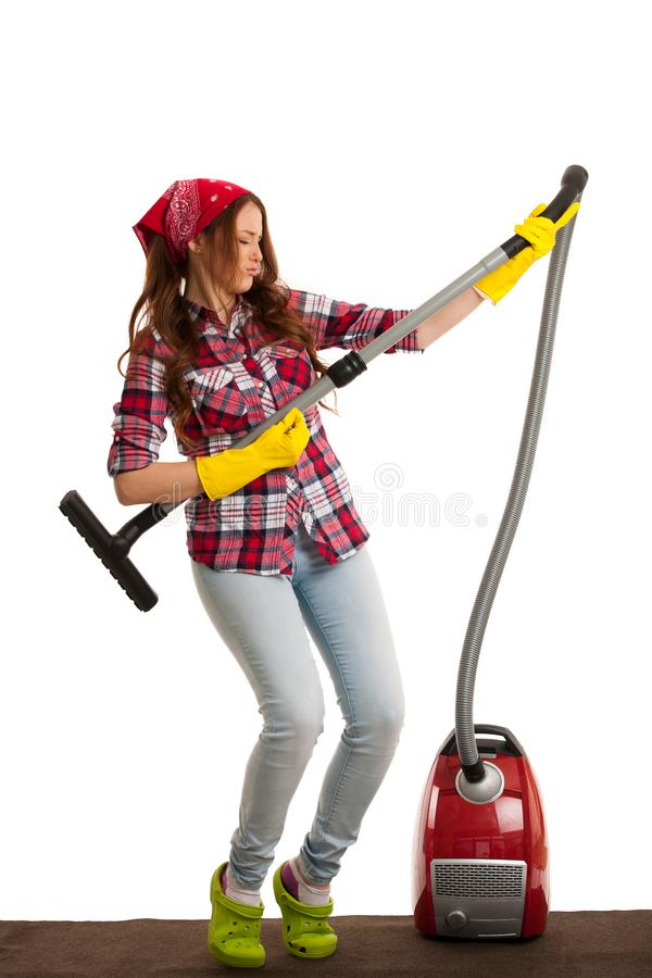Happy young woman singing as she is cleaning with vacuum cleaner stock images