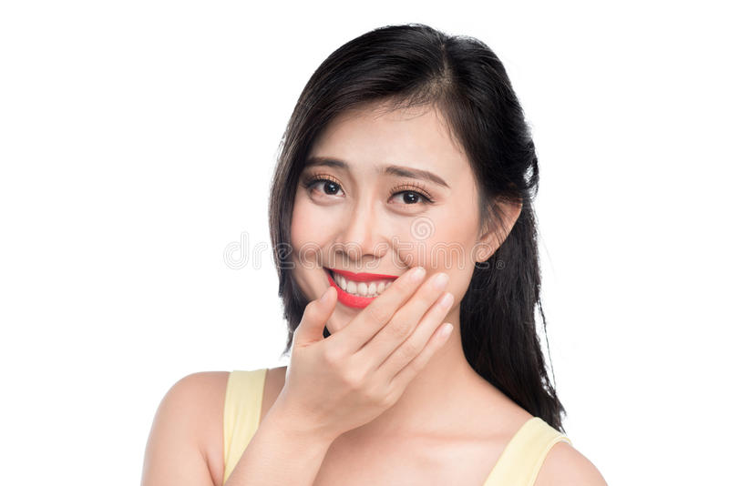 Happy young woman smiling covering her mouth with her hand royalty free stock images