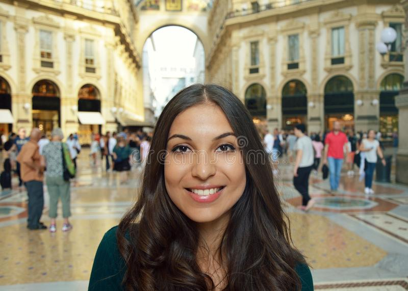 Happy young woman smiling inside of the world`s oldest shopping mall Galleria Vittorio Emanuele II Milan city, Italy.  stock image