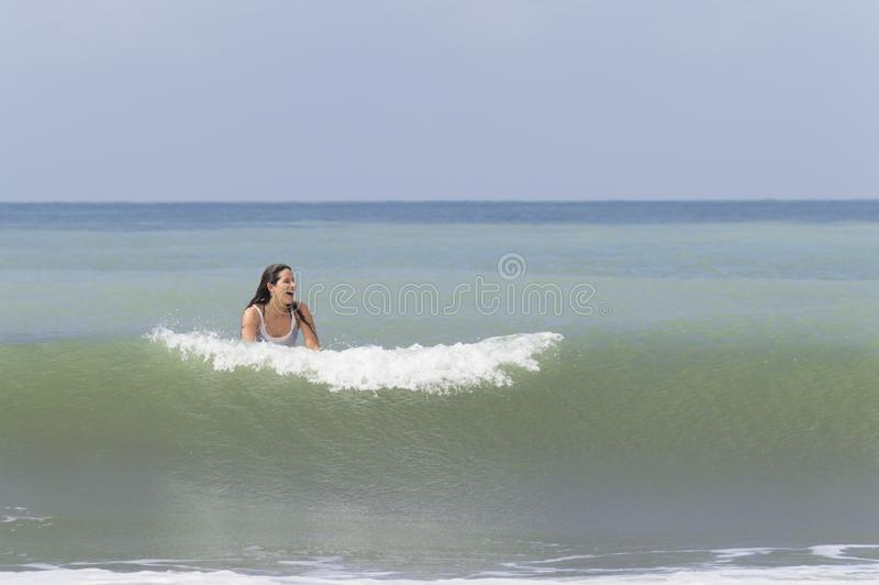 Happy young woman smiling in the ocean stock image