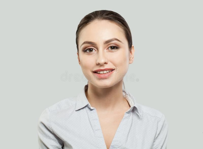 Happy young woman smiling on white background royalty free stock photo