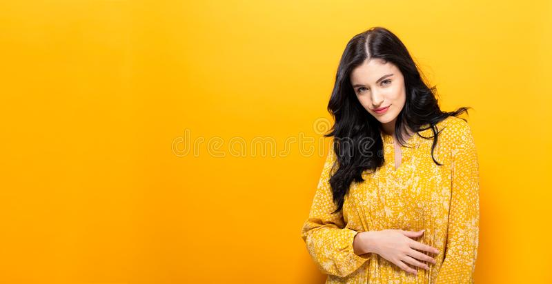 Happy young woman on a solid background royalty free stock photography