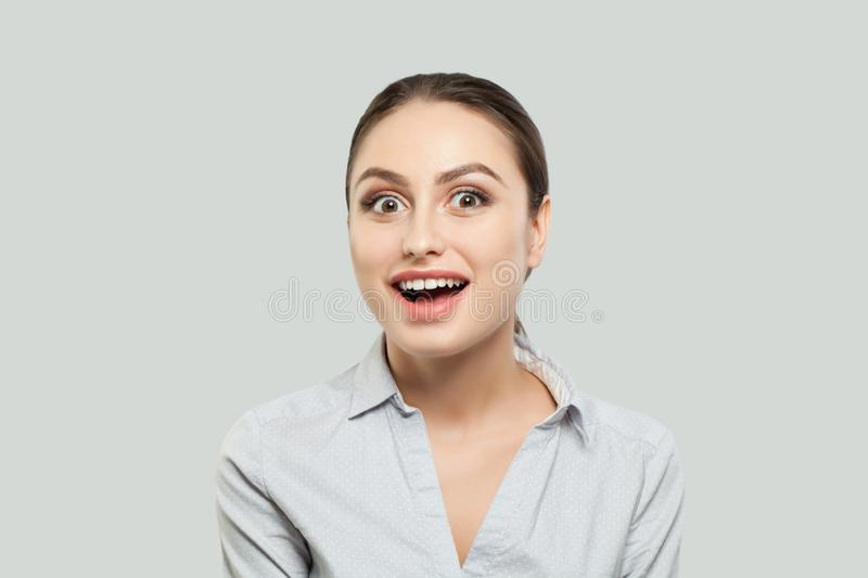 Happy young woman student. Surprised female model girl on white background. royalty free stock images