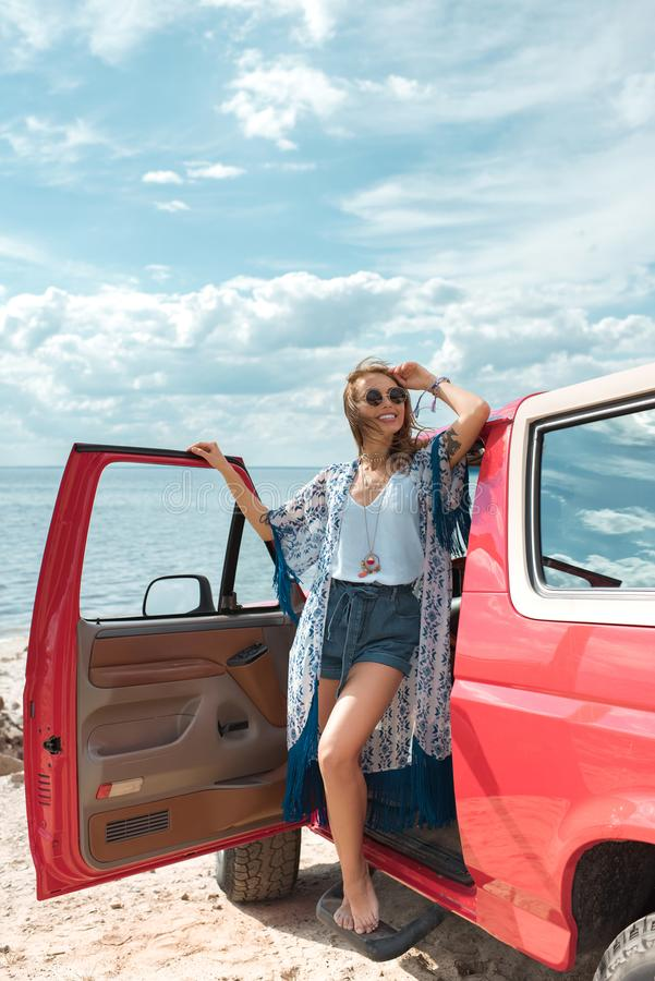 happy young woman in sunglasses standing royalty free stock photos