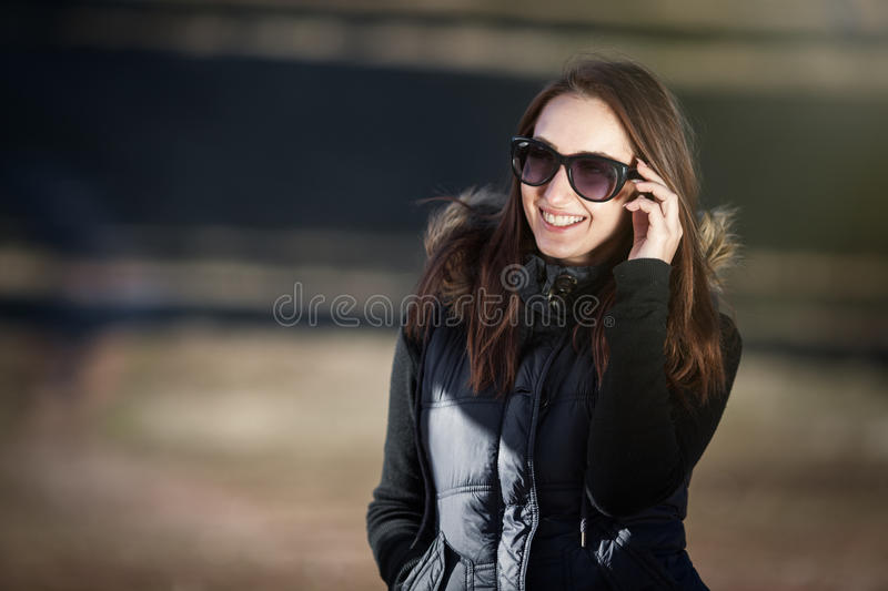 Happy young woman with sunglasses royalty free stock photography