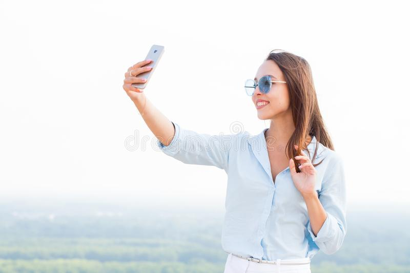 Happy young woman taking selfie and smiling. Lifestyle, leisure, travel. Concepts stock images