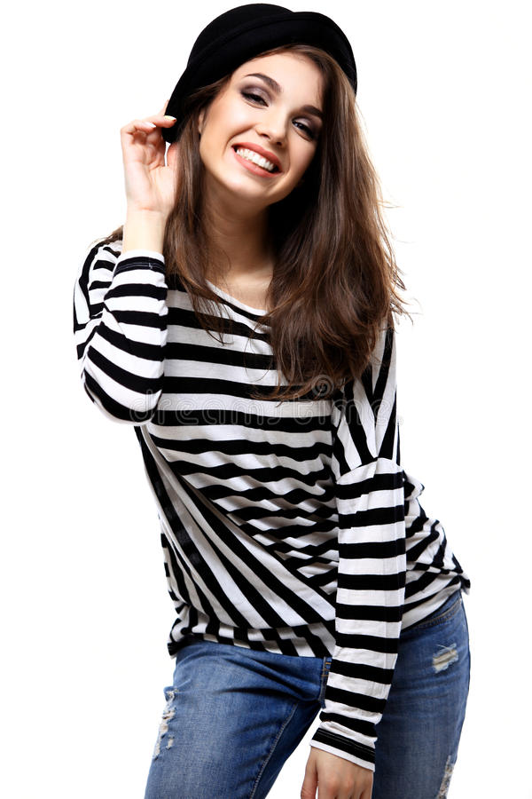 Happy young woman or teen girl in casual clothes and hipster hat royalty free stock photo