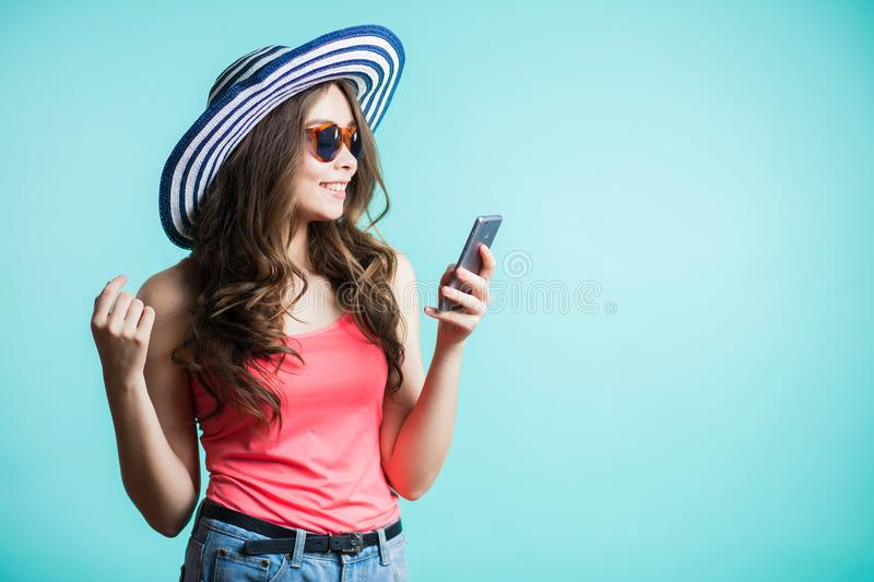 Happy young woman texting on smartphone. technology, communication royalty free stock images