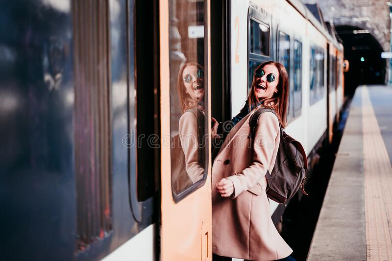 happy young woman at train station. Travel concept royalty free stock photos
