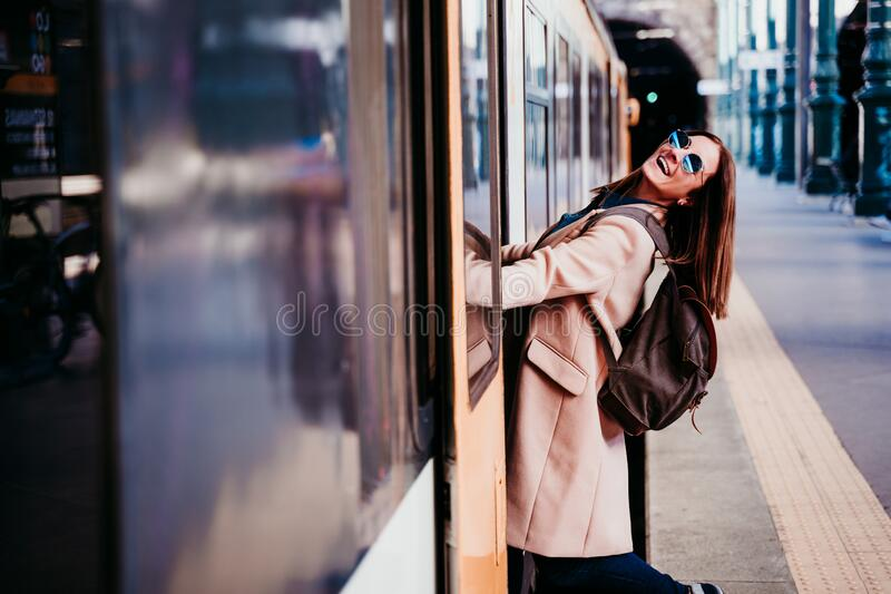 happy young woman at train station. Travel concept stock images
