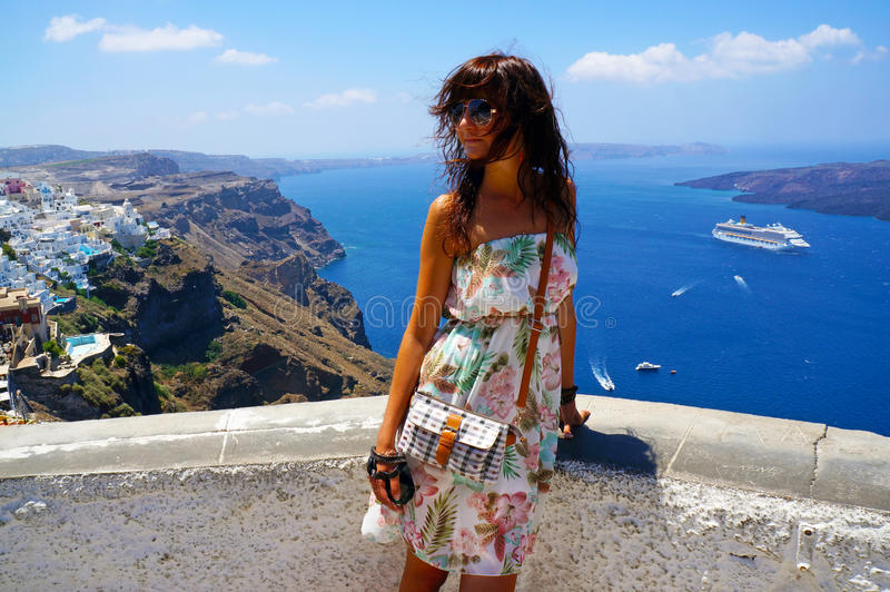Happy young woman in a travel. Santorini stock images