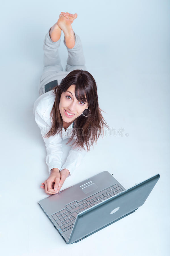 Download Happy Young Woman Using Laptop Stock Photo - Image of cheerful, commerce: 23361850