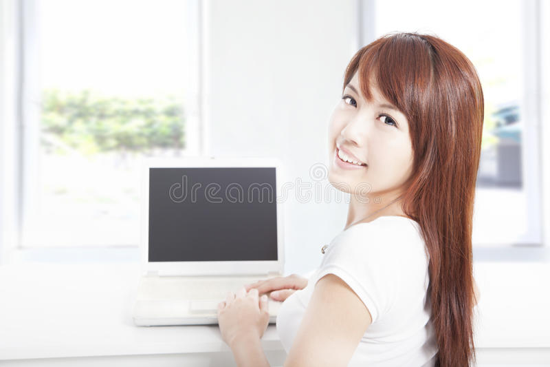 Download Happy Young Woman Using The Laptop At Home Stock Photo - Image: 25976436