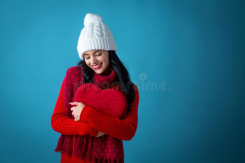 Happy young woman with an Valentine`s day heart royalty free stock images
