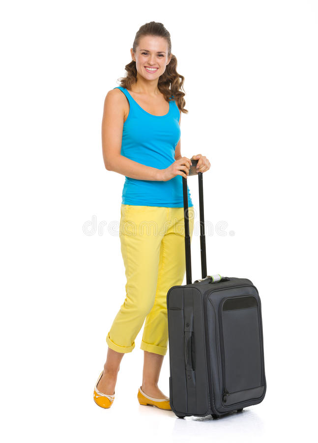 Happy young woman with wheel bag going on vacation royalty free stock image
