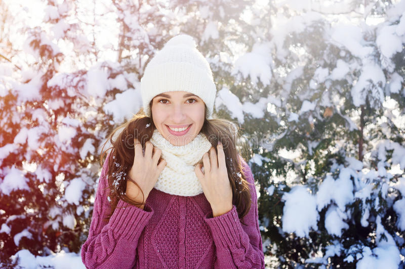 Happy young woman in a white knitted hat and scarf in Winter Park.  stock images
