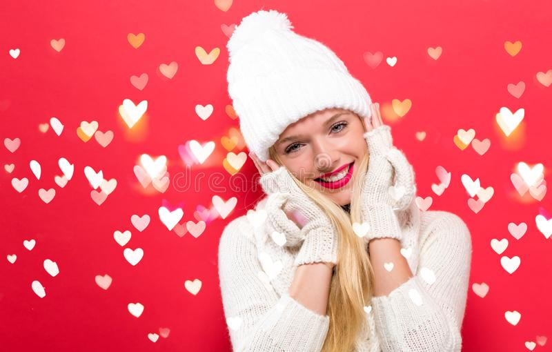 Happy young woman in winter clothes royalty free stock images
