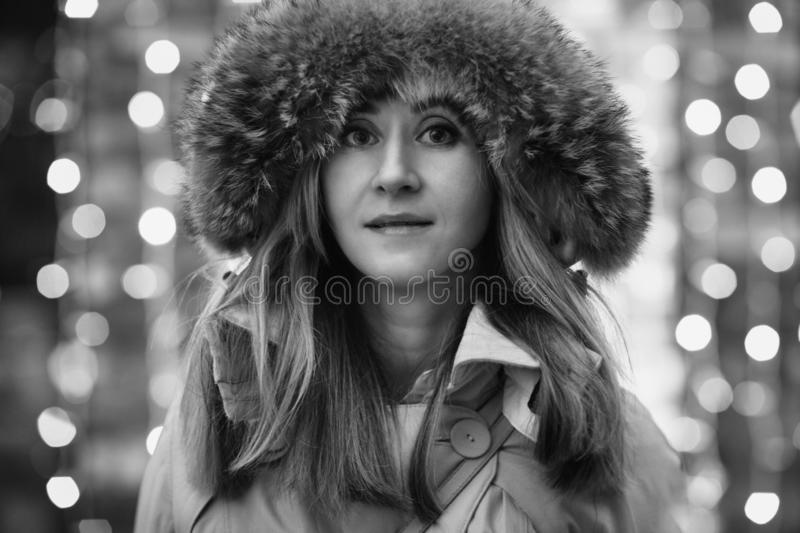 Happy young woman in the winter street. stock photography