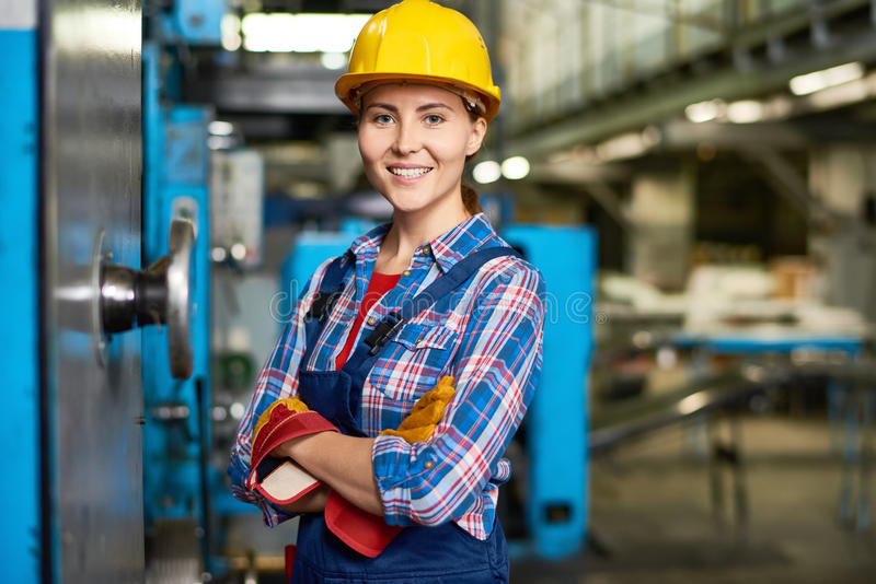 Happy Young Woman Working at Factory stock image