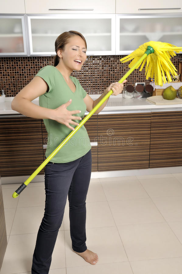 happy young women fun cleaning stock photography