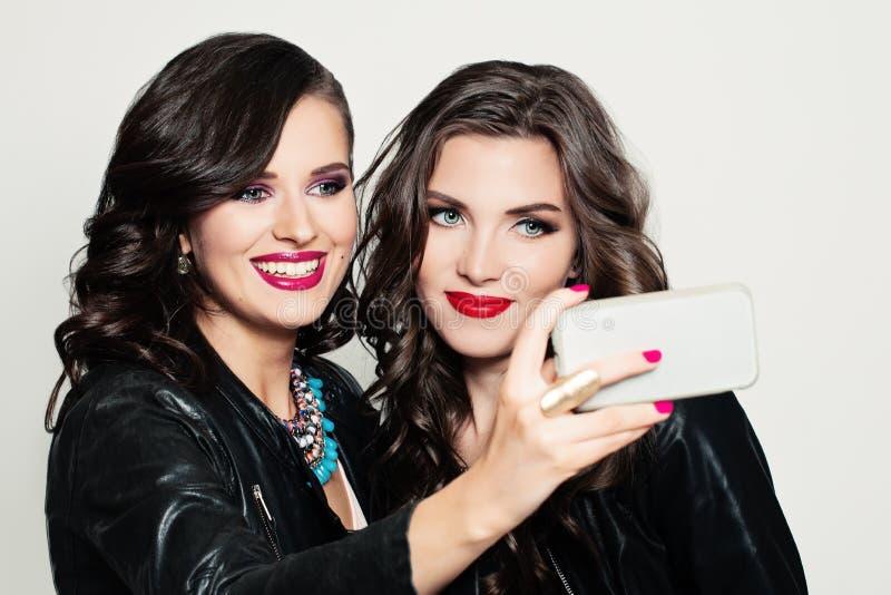 Happy Young Women. Selfie. Fashion Portrait stock images