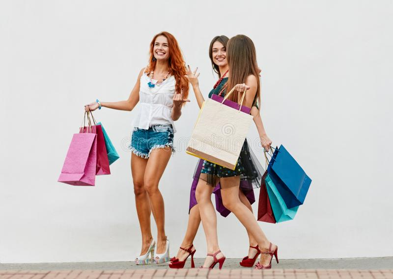 Happy female shoppers stock photos