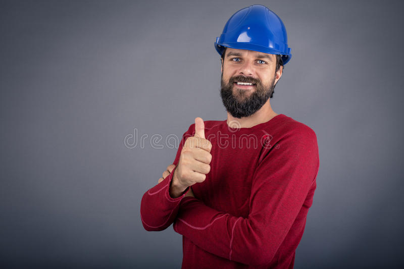 Happy young worker with hardhat showing ok sign royalty free stock images