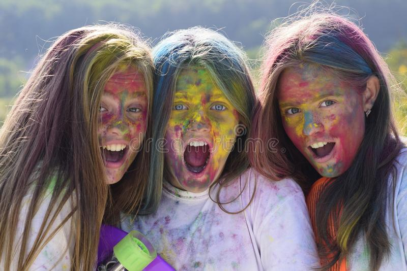 Happy youth party. Optimist. Spring vibes. children with creative body art. Crazy hipster girls. Summer weather. Positive and cheerful. colorful neon paint royalty free stock image