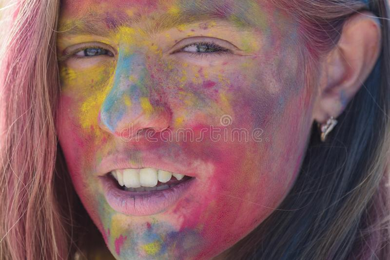 Happy youth party. Optimist. Spring vibes. colorful neon paint makeup. child with creative body art. Crazy hipster girl royalty free stock photo