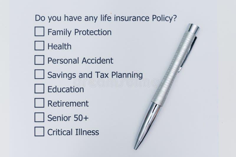 Har du någon livförsäkringpolitik? Det fråga för ` s A som ska svaras arkivfoton