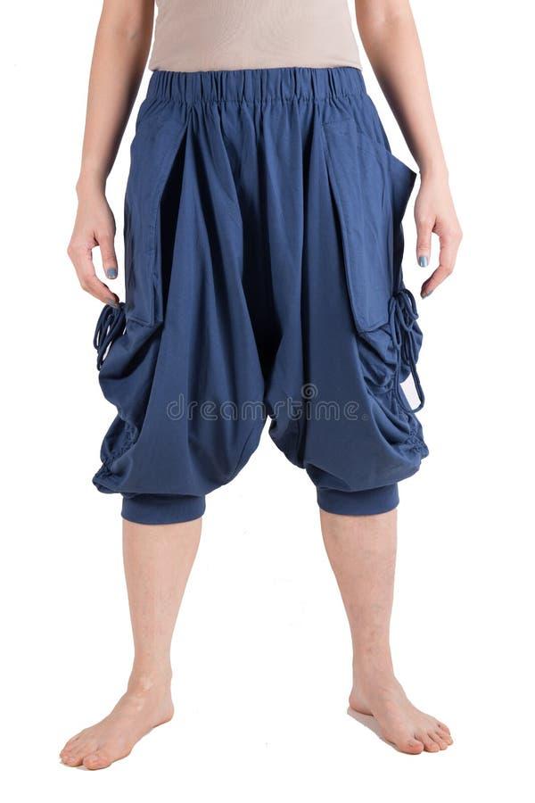 Haram裤子被隔绝在白色 库存图片