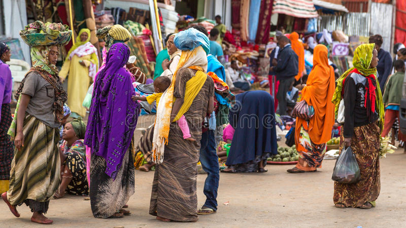 Harar Jugol. HARAR, ETHIOPIA - JULY 27,2014 - Local residents of Harar,considered as the fourth holy city of Islam, shopping in the street markets near the stock photography