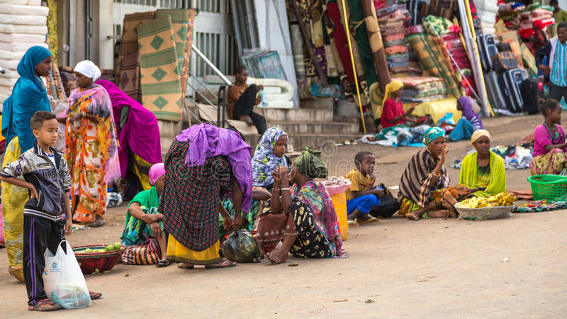 Harar Jugol. HARAR, ETHIOPIA - JULY 27,2014 - Local residents of Harar,considered as the fourth holy city of Islam, shopping in the street markets near the royalty free stock image