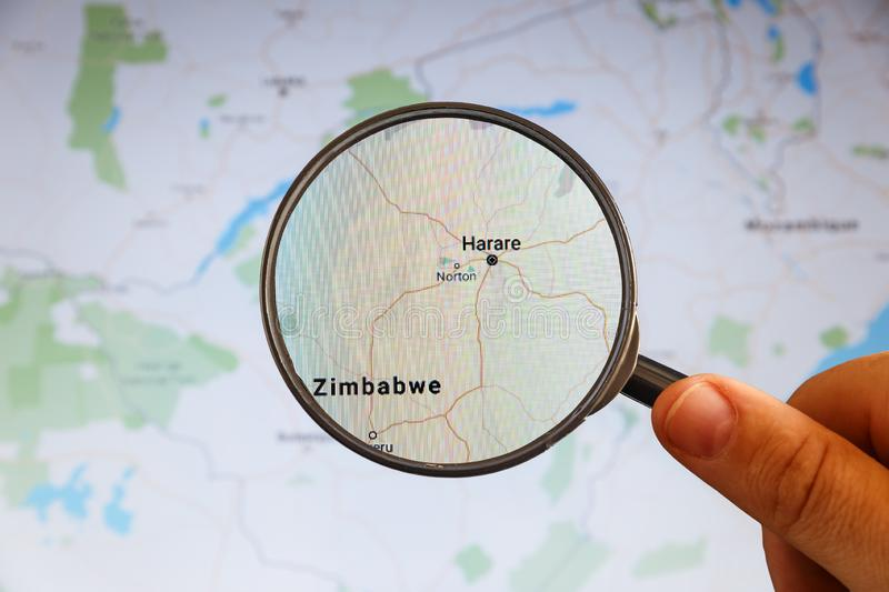 Harare, Zimbabwe. Political map. City visualization illustrative concept on display screen through magnifying glass in the hand stock photo