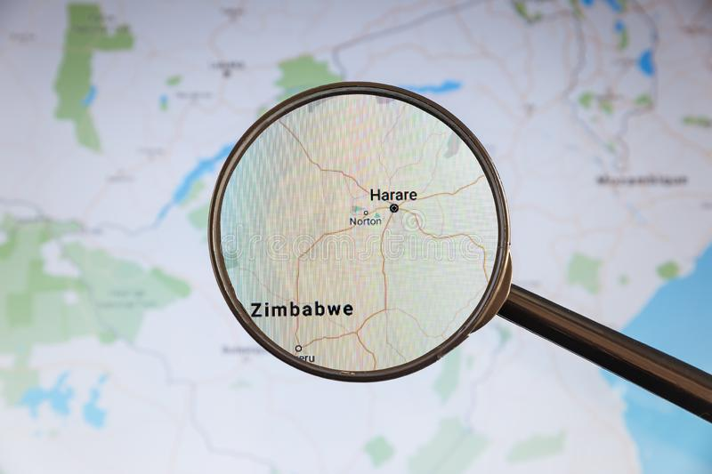 Harare, Zimbabwe. Political map. City visualization illustrative concept on display screen through magnifying glass royalty free stock images