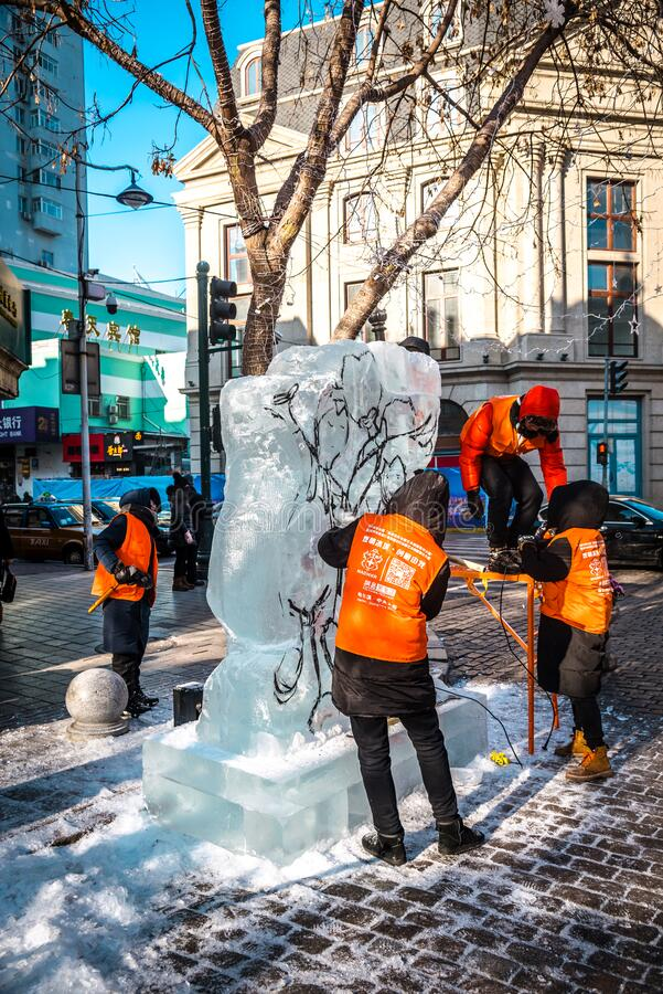 HARBIN, CHINA - DEC 30, 2018 : Ice sculptures, The workers are carve ice into various shape, located in Zhongyang Street Central. Street at Harbin City stock photo