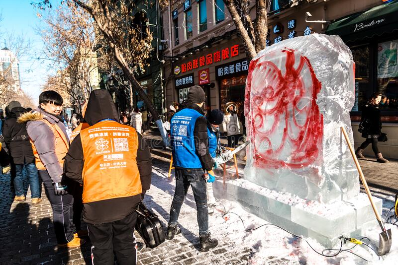 HARBIN, CHINA - DEC 30, 2018 : Ice sculptures, The workers are carve ice into various shape, located in Zhongyang Street Central. Street at Harbin City royalty free stock photo
