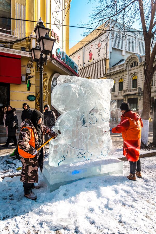 HARBIN, CHINA - DEC 30, 2018 : Ice sculptures, The workers are carve ice into various shape, located in Zhongyang Street Central. Street at Harbin City royalty free stock image